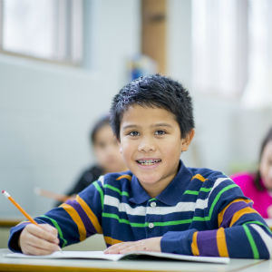 Smiling elementary student with braces
