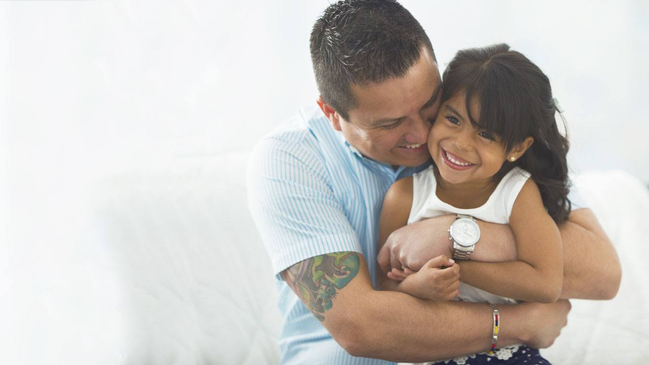 Hispanic father and young daughter